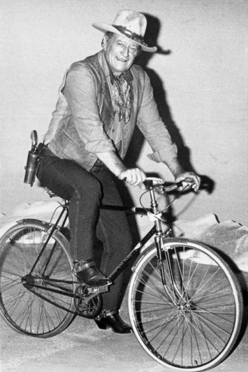 Fewer things more than The Duke on a Schwinn embody what it means  to be Conveniently Texan