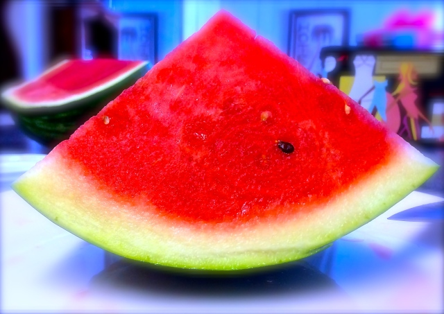 PITY THE FOOL - One lonely speck of a seed floats solo in a seedless watermelon sea.