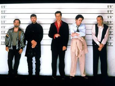 Just because he wasn't part of THE Flipmode Squad, Fred Fenster (center, played by Benicio Del Toro) would flip ya' for real.
